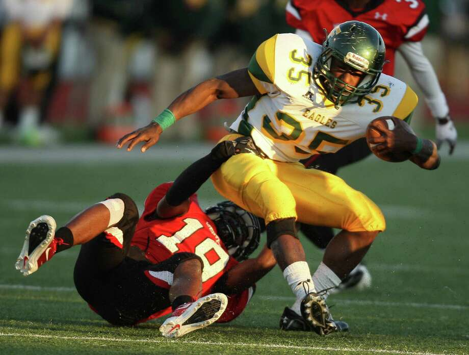 Klein Forest running back Anthony Brisco (35) is tackled for a loss by Westfield defensive back Cameron Scott during the second half of a high school football game, Saturday, October 27, 2012 at George Stadium in Spring, TX. Photo: Eric Christian Smith, For The Chronicle