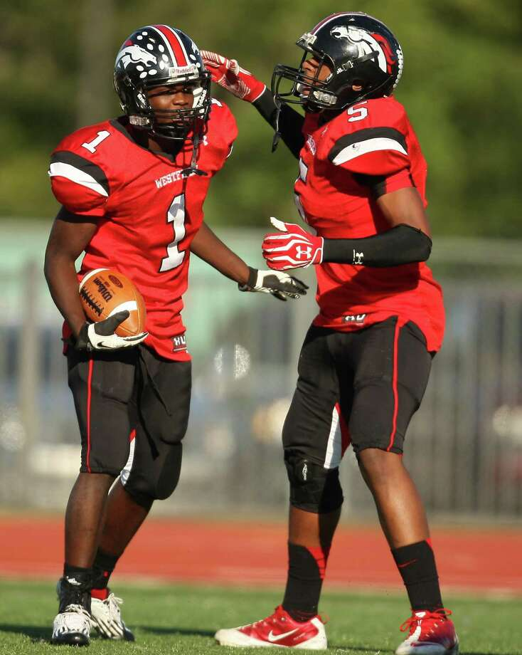 Westfield wide receiver Tevin Lewis (1) celebrates his 19-yard touchdown reception with Jordan Jones during the first half of a high school football game, Saturday, October 27, 2012 at George Stadium in Spring, TX. Photo: Eric Christian Smith, For The Chronicle