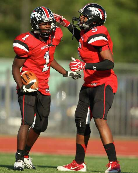 Westfield wide receiver Tevin Lewis (1) celebrates his 19-yard touchdown reception with Jordan Jones