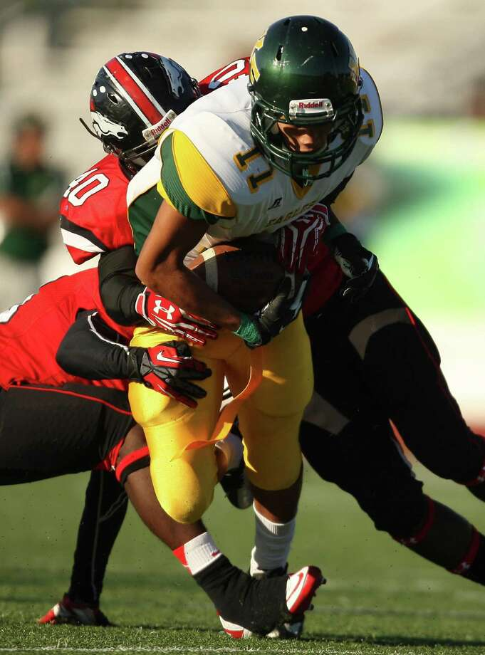 Klein Forest wide receiver Levi House (11) is tackled by Westfield linebacker Bradley Boyd during the first half of a high school football game, Saturday, October 27, 2012 at George Stadium in Spring, TX. Photo: Eric Christian Smith, For The Chronicle