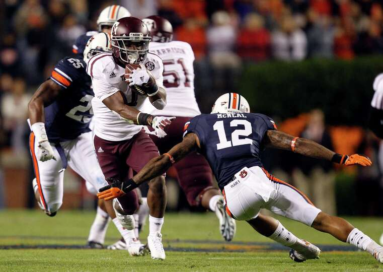Texas A&M running back Ben Malena (1) tries to get around Auburn defensive back Demetruce McNeal (12