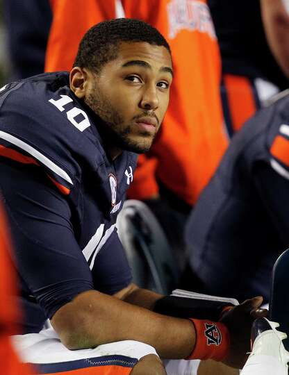 Auburn quarterback Kiehl Frazier (10) looks at the scoreboard as Texas A&M puts up another score dur