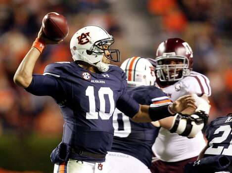Auburn quarterback Kiehl Frazier (10) throws a pass against Texas A&M during the second half of an NCAA college football game on Saturday, Oct. 27, 2012, in Auburn, Ala. Texas A&M defeated Auburn 63-21. (AP Photo/Butch Dill) Photo: Butch Dill, Associated Press / FR111446 AP