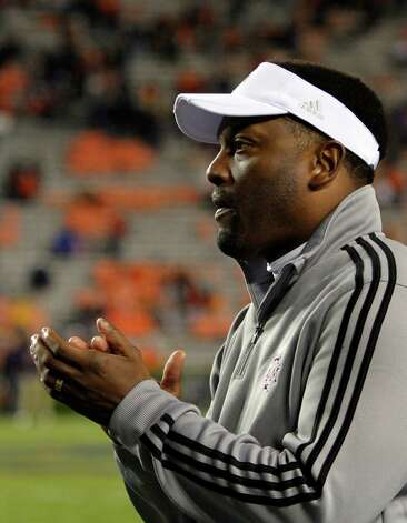 Texas A&M Coach Kevin Sumlin applauds his team as they defeat Auburn 63-21 during the second half of an NCAA college football game on Saturday, Oct. 27, 2012, in Auburn, Ala. (AP Photo/Butch Dill) Photo: Butch Dill, Associated Press / FR111446 AP