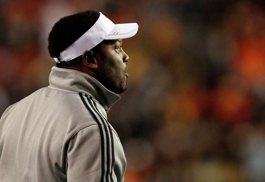 Texas A&M Coach Kevin Sumlin calls in a play from the sideline during the first half of an NCAA college football game against Auburn, Saturday, Oct. 27, 2012, in Auburn, Ala. (AP Photo/Butch Dill) Photo: Butch Dill, Associated Press / FR111446 AP