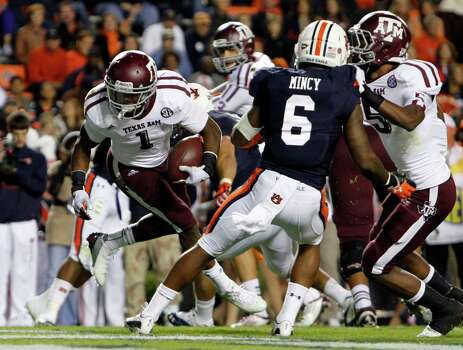Texas A&M running back Ben Malena (1) spins his way into the end zone for a touchdown against Auburn during the second half of an NCAA college football game on Saturday, Oct. 27, 2012, in Auburn, Ala. (AP Photo/Butch Dill) Photo: Butch Dill, Associated Press / FR111446 AP