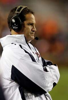 Auburn coach Gene Chizik watches from the sidelines as Texas A&M scores another touchdown during the second half of an NCAA college football game on Saturday, Oct. 27, 2012, in Auburn, Ala. (AP Photo/Butch Dill) Photo: Butch Dill, Associated Press / FR111446 AP