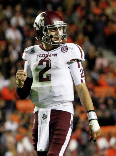 Texas A&M 63, Auburn 21 Texas A&M quarterback Johnny Manziel (2) celebrates after his tea
