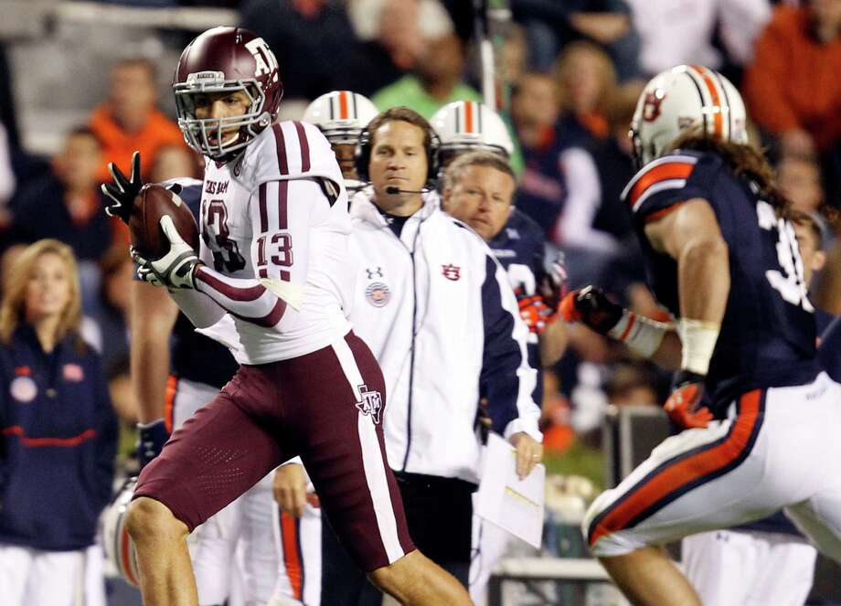 Texas A&M wide receiver Mike Evans (13) catches a pass for a first down over Auburn linebacker Cassanova McKinzy (30) during the second half of an NCAA college football game on Saturday, Oct. 27, 2012, in Auburn, Ala. (AP Photo/Butch Dill) Photo: Butch Dill, Associated Press / FR111446 AP