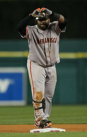 Third baseman Pablo Sandoval flashes a heart after doubling in the eighth inning. Photo: Lance Iversen, The Chronicle