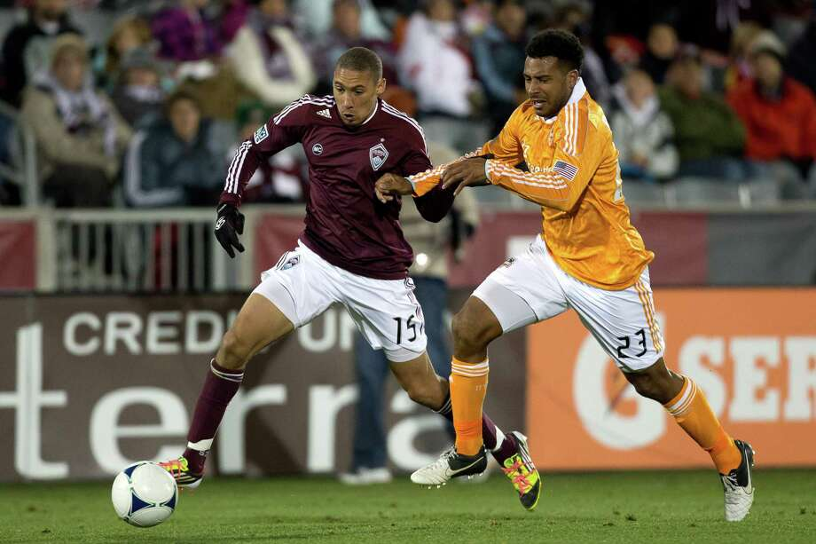 COMMERCE CITY, CO - OCTOBER 27:  Chris Klute #15 of the Colorado Rapids and Giles Barnes #23 of the Houston Dynamo battle for the ball during the second half at Dick's Sporting Goods Park on October 27, 2012 in Commerce City, Colorado. The Rapids defeated the Dynamo 2-0. Photo: Justin Edmonds, Getty Images / Getty Images North America