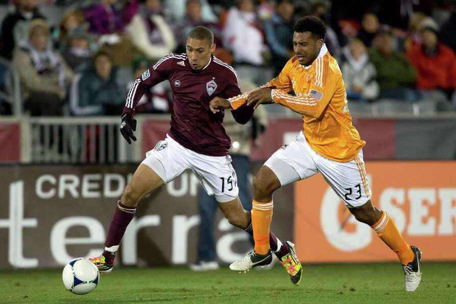COMMERCE CITY, CO - OCTOBER 27:  Chris Klute #15 of the Colorado Rapids and Giles Barnes #23 of the