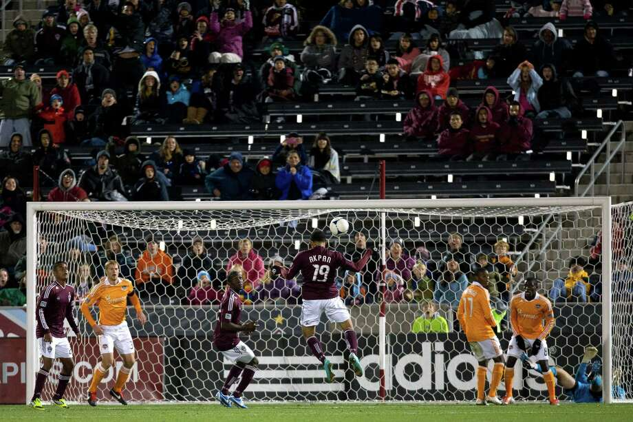 COMMERCE CITY, CO - OCTOBER 27:  Andre Akpan #19 of the Colorado Rapids heads the ball into the net for a goal during the second half against the Houston Dynamo at Dick's Sporting Goods Park on October 27, 2012 in Commerce City, Colorado. The Rapids defeated the Dynamo 2-0. Photo: Justin Edmonds, Getty Images / Getty Images North America
