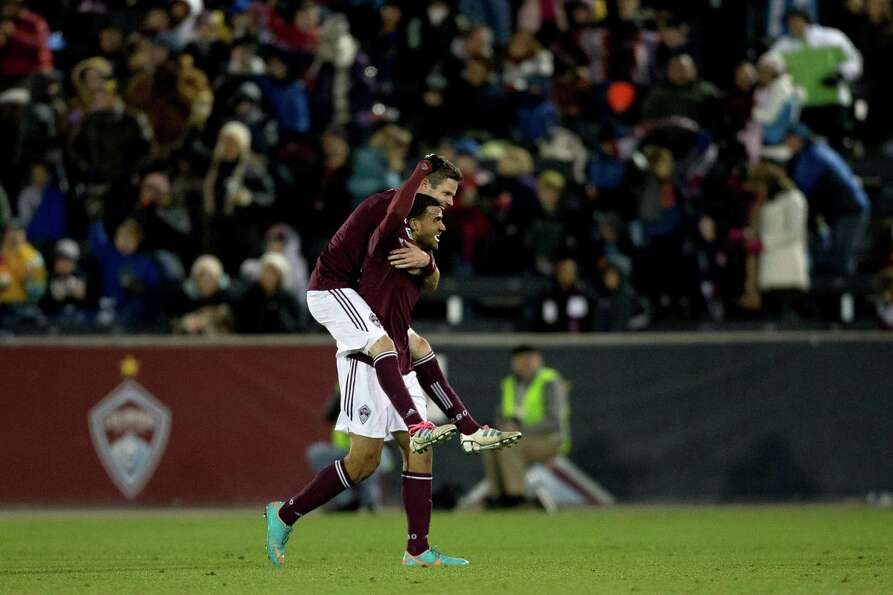COMMERCE CITY, CO - OCTOBER 27:  Drew Moor #3 of the Colorado Rapids jumps on Andre Akpan #19 as the