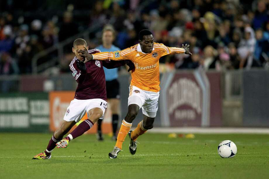 COMMERCE CITY, CO - OCTOBER 27:  Je-Vaughn Watson #10 of the Houston Dynamo uses his had to ward off Chris Klute #15 of the Colorado Rapids as they battle for the ball during the first half at Dick's Sporting Goods Park on October 27, 2012 in Commerce City, Colorado. Photo: Justin Edmonds, Getty Images / Getty Images North America