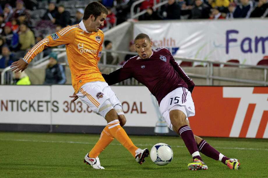 COMMERCE CITY, CO - OCTOBER 27:  Chris Klute #15 of the Colorado Rapids cuts the ball back against Nathan Sturgis #6 of the Houston Dynamo at Dick's Sporting Goods Park on October 27, 2012 in Commerce City, Colorado. Photo: Justin Edmonds, Getty Images / Getty Images North America