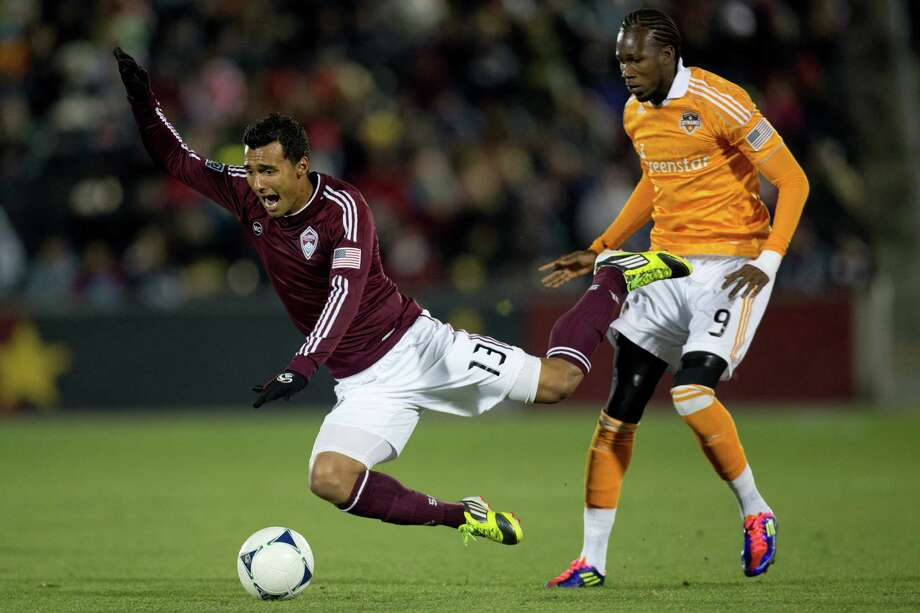 COMMERCE CITY, CO - OCTOBER 27:  Kamani Hill #13 of the Colorado Rapids is fouled by Macoumba Kandji #9 of the Houston Dynamo during the first half at Dick's Sporting Goods Park on October 27, 2012 in Commerce City, Colorado. Photo: Justin Edmonds, Getty Images / Getty Images North America