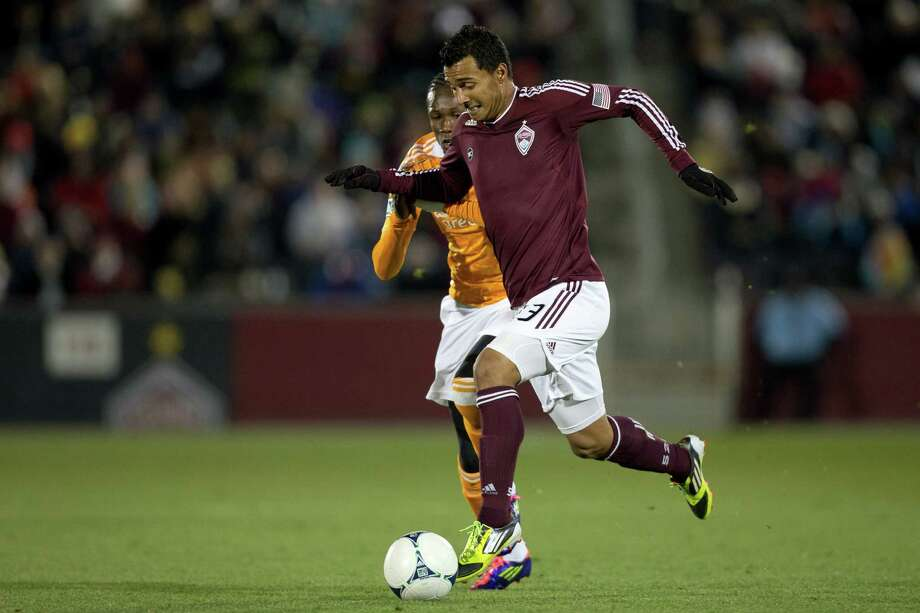 COMMERCE CITY, CO - OCTOBER 27:  Kamani Hill #13 of the Colorado Rapids controls the ball against Macoumba Kandji #9 of the Houston Dynamo during the first half at Dick's Sporting Goods Park on October 27, 2012 in Commerce City, Colorado. Photo: Justin Edmonds, Getty Images / Getty Images North America