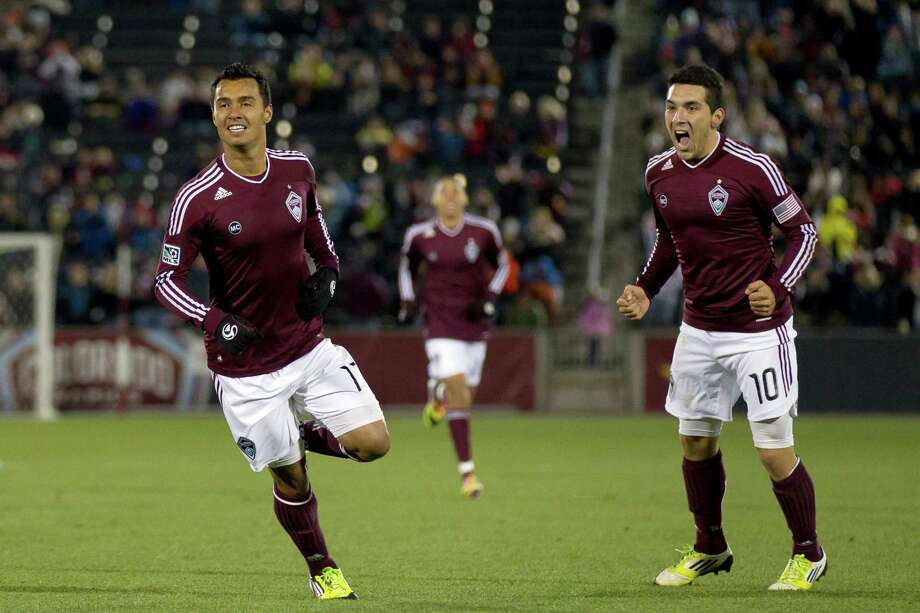 COMMERCE CITY, CO - OCTOBER 27:  Kamani Hill #13 of the Colorado Rapids celebrates after scoring during the first half against the Houston Dynamo with teammate Martin Rivero #10 at Dick's Sporting Goods Park on October 27, 2012 in Commerce City, Colorado. Photo: Justin Edmonds, Getty Images / Getty Images North America
