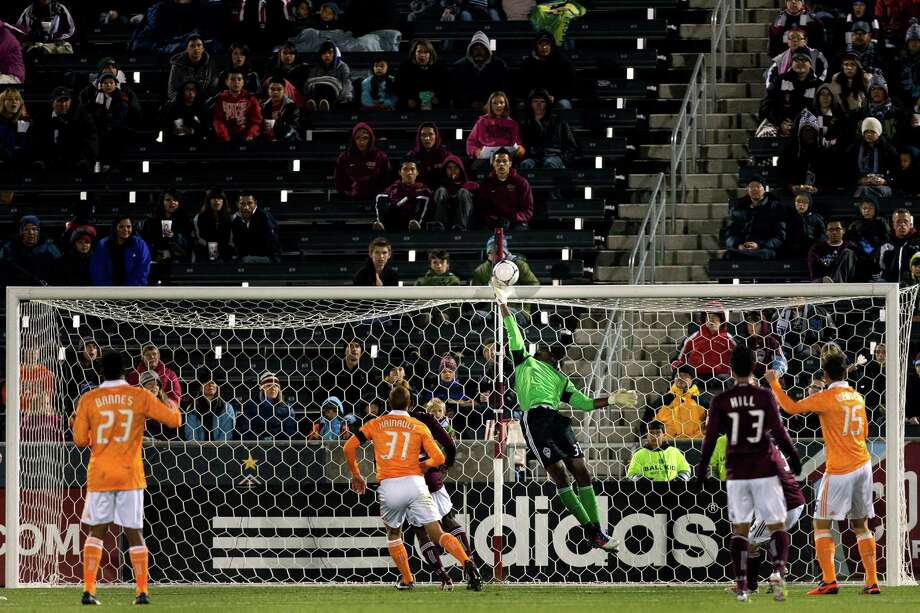 COMMERCE CITY, CO - OCTOBER 27:  Goalkeeper Steward Ceus #31 of the Colorado Rapids tips the ball over the crossbar during the first half against the Houston Dynamo at Dick's Sporting Goods Park on October 27, 2012 in Commerce City, Colorado. Photo: Justin Edmonds, Getty Images / Getty Images North America