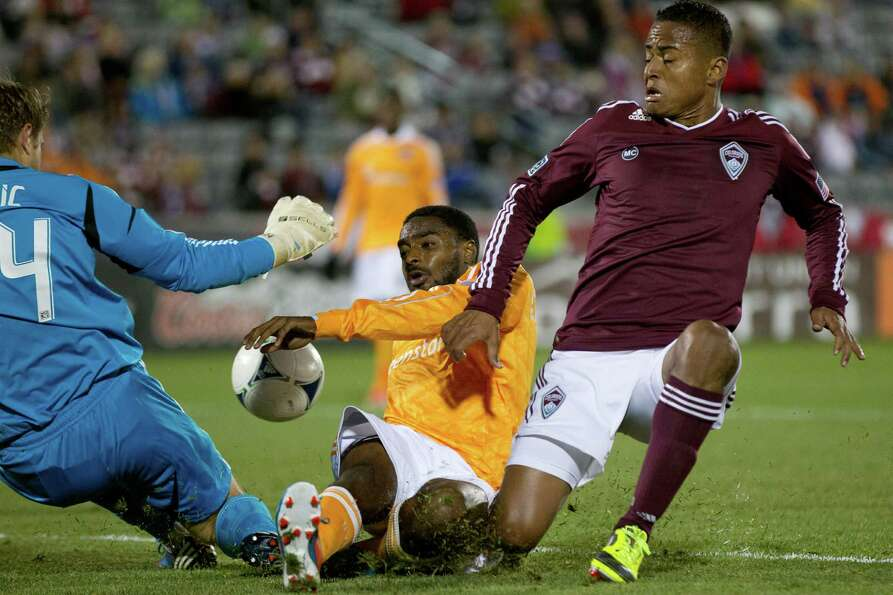 COMMERCE CITY, CO - OCTOBER 27:  Jaime Castrillon #23 of the Colorado Rapids collides with Warren Cr
