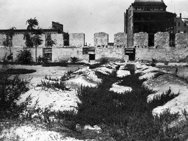 Rubble on the Alamo grounds before the restoration of the Long Barrack could've been the source of Alamo stone embedded in Tribune Tower. Photo: Courtesy Sarah Reveley