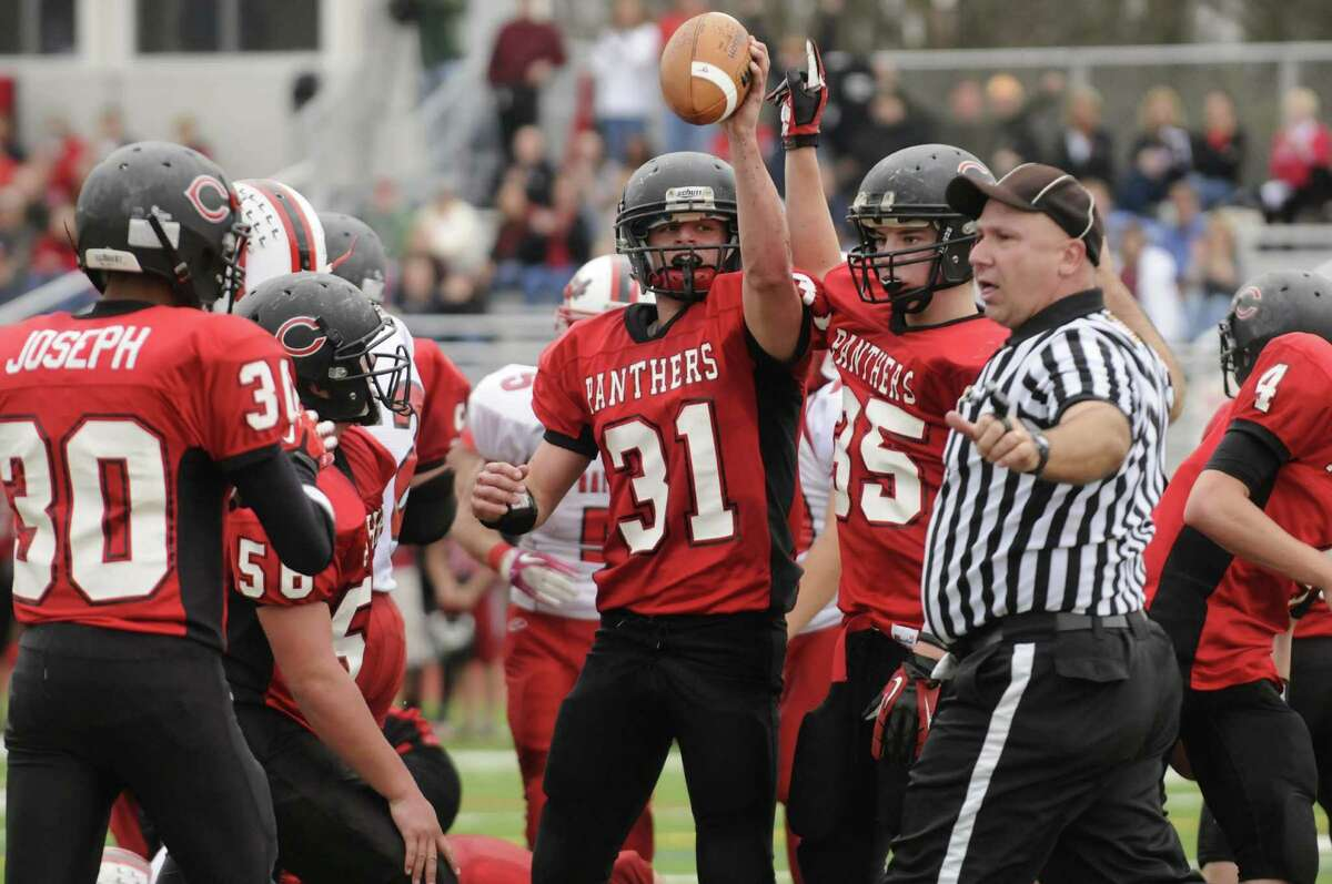 Chatham's Jesse Whiteman holds up the ball after a goal line defensive fumble recovery during their semifinal high school football game against Mechanicville in Stillwater, NY Saturday Oct. 27, 2012. (Michael P. Farrell/Times Union)