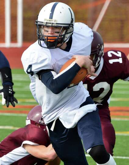 Rensselaer's #4 Jake Forgea carries for a touch down against Whitehall during Saturday's semifinal g