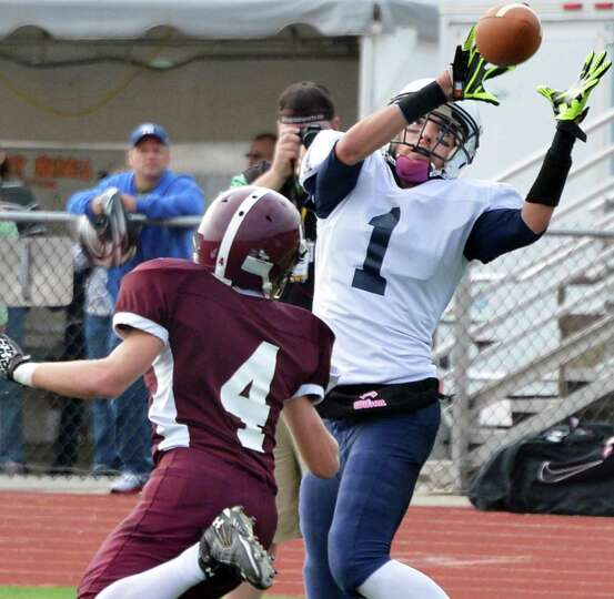Rensselaer's #1Tyler Oliver catches a pass during Saturday's semifinal game against Whitehall at Sch