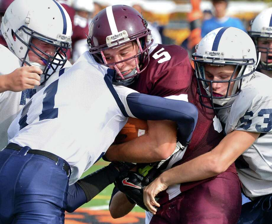 Whitehall's #5 Josh Hoagland, center, gets enveloped by Rensselaer defenders during Saturday's semifinal game at Schuylerville High School  Oct. 27, 2012.  (John Carl D'Annibale / Times Union) Photo: John Carl D'Annibale / 00019853A