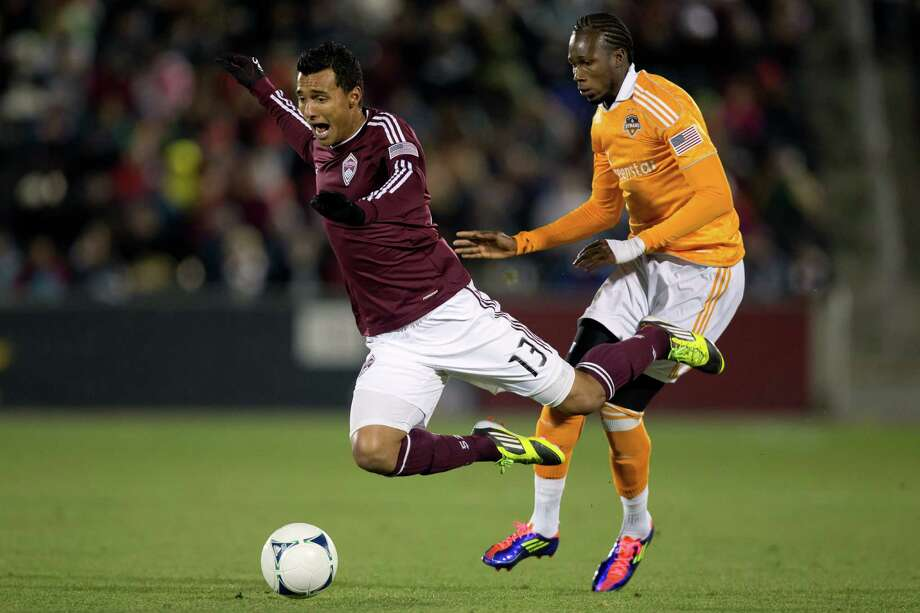 Colorado's Kamani Hill, left, gets tripped up by the Dynamo's Macoumba Kandji early, but the Rapids didn't suffer the same fate, winning 2-0 on Saturday. Photo: Justin Edmonds, Stringer / Getty Images North America