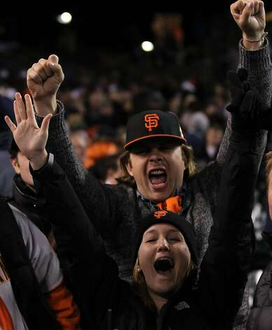 San Francisco Giants fans celebrate their 2-0 win in game three of the World Series with the Detroit Tigers  at Comerica Park in Detroit, Mi., on Saturday, Oct. 27, 2012. Photo: Lance Iversen, The Chronicle