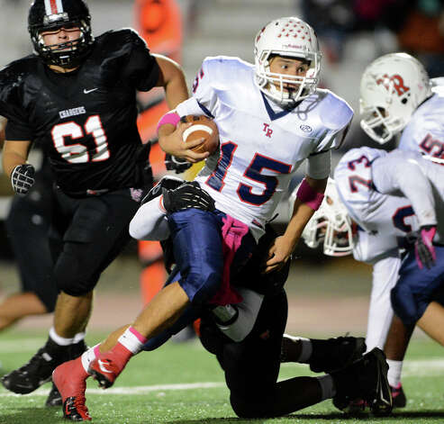 Roosevelt's Jacob Preciado (15) scrambles out of the pocket during a district 26-5A football game between the Roosevelt Rough Riders and the Churchill Chargers at Comalander Stadium in San Antonio, Saturday, October 27, 2012.