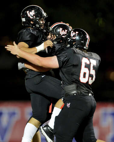 Churchill's Nicholas Smisek (left) is congratulated by Robert O'Hare (88) and Michael Cameron (65) after Smisek scored a touchdown during a district 26-5A football game between the Roosevelt Rough Riders and the Churchill Chargers at Comalander Stadium in San Antonio, Saturday, October 27, 2012. John Albright / Special to the Express-News. Photo: JOHN ALBRIGHT, Express-News / San Antonio Express-News