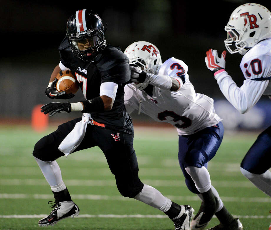 Churchill's Justice King (7) escapes the tackle of Roosevelt's Khalid Mitchell (3) during a district 26-5A football game between the Roosevelt Rough Riders and the Churchill Chargers at Comalander Stadium in San Antonio, Saturday, October 27, 2012. John Albright / Special to the Express-News. Photo: JOHN ALBRIGHT, Express-News / San Antonio Express-News