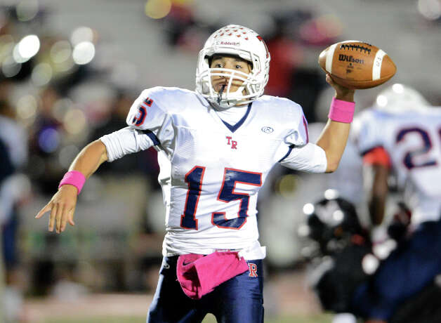 Roosevelt quarterback Jacob Preciado (15) throws a pass during a district 26-5A football game between the Roosevelt Rough Riders and the Churchill Chargers at Comalander Stadium in San Antonio, Saturday, October 27, 2012.
