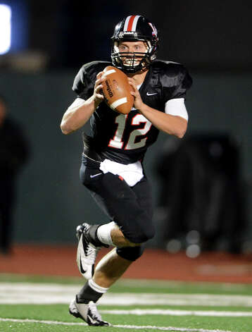 Churchill quarterback Nate Pearson (12) during a district 26-5A football game between the Roosevelt Rough Riders and the Churchill Chargers at Comalander Stadium in San Antonio, Saturday, October 27, 2012.