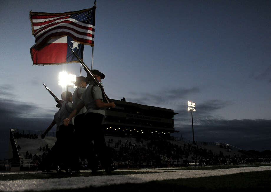 The Churchill JR-ROTC presents the colors before a district 26-5A football game between the Roosevelt Rough Riders and the Churchill Chargers at Comalander Stadium in San Antonio, Saturday, October 27, 2012.