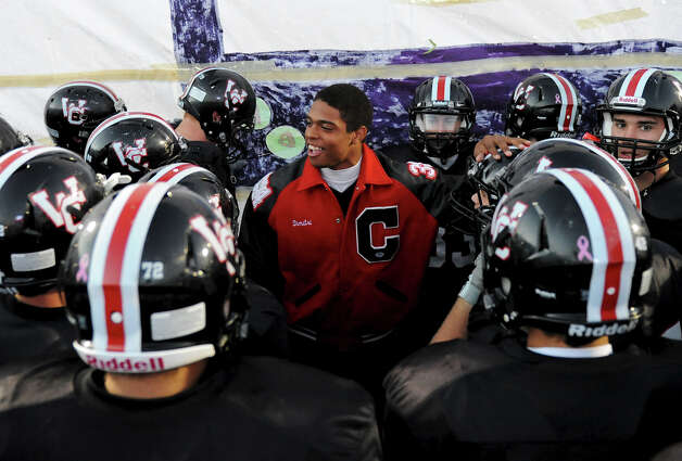 Churchill's Dimitri Flowers (center) talks to his teammates before they take the field for a district 26-5A football game between the Roosevelt Rough Riders and the Churchill Chargers at Comalander Stadium in San Antonio, Saturday, October 27, 2012.  Flowers did not play due to an injury. 