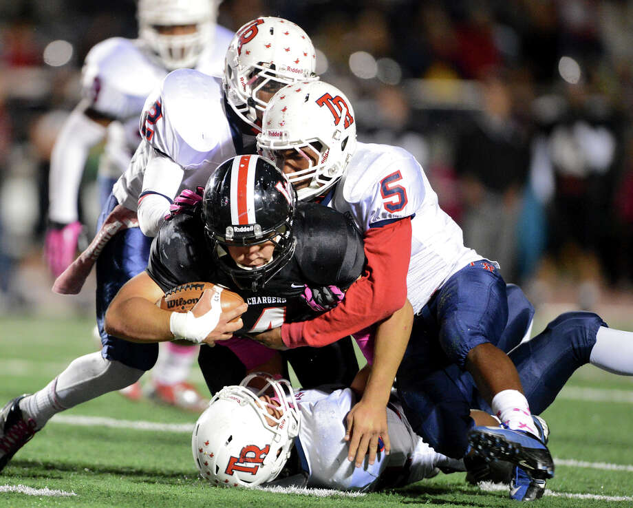 Churchill's Nicholas Smisek (4) dives through a group of Roosevelt defenders during a district 26-5A football game between the Roosevelt Rough Riders and the Churchill Chargers at Comalander Stadium in San Antonio, Saturday, October 27, 2012. John Albright / Special to the Express-News. Photo: JOHN ALBRIGHT, Express-News / San Antonio Express-News