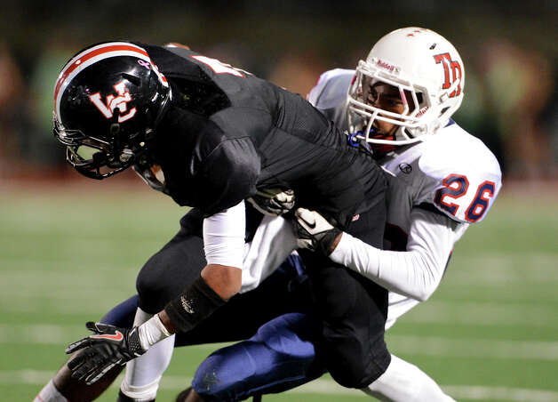 Roosevelt's Will Porter (26) tackles Churchill's Justice King (7) during a district 26-5A football game between the Roosevelt Rough Riders and the Churchill Chargers at Comalander Stadium in San Antonio, Saturday, October 27, 2012.
