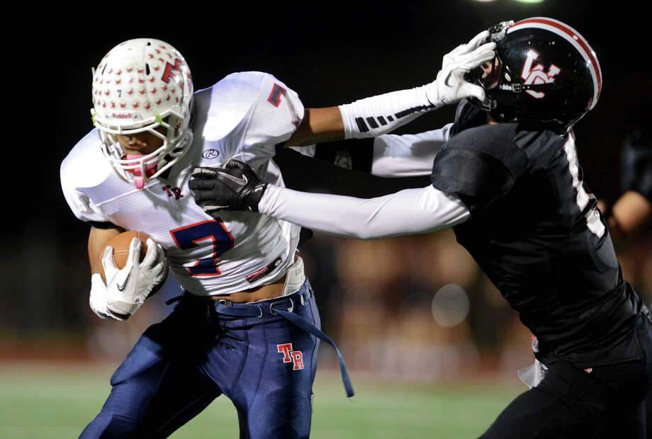 Roosevelt's Steven Marshall (7) stiff-arms Churchill's Colton Teis (5) during a district 26-5A football game between the Roosevelt Rough Riders and the Churchill Chargers at Comalander Stadium in San Antonio, Saturday, October 27, 2012.