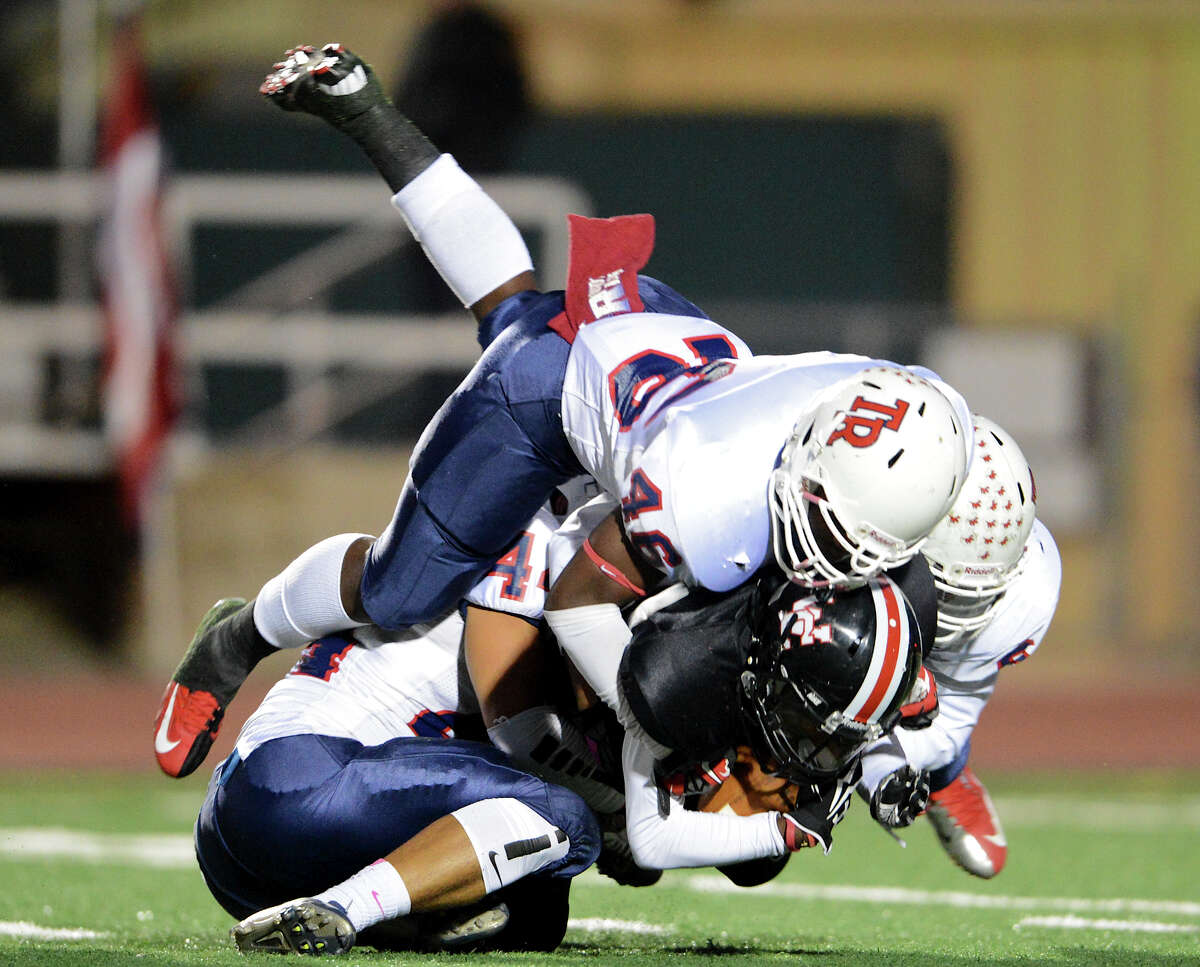 Rooservelt's Rashad Lafond (46), Jeffrey Bryson (44) and Trae Gardner (6) tackle Churchill's Colton Teis (5) during a district 26-5A football game between the Roosevelt Rough Riders and the Churchill Chargers at Comalander Stadium in San Antonio, Saturday, October 27, 2012. John Albright / Special to the Express-News.