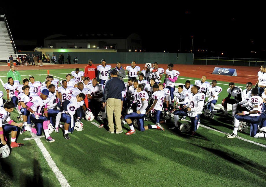 Roosevelt head coach Neal La Hue talks to his players after defeating Churchill during a district 26-5A football game at Comalander Stadium in San Antonio, Saturday, October 27, 2012.