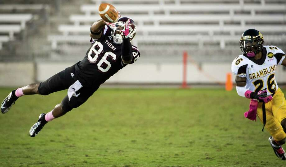 Texas Southern receiver James Davis gets separation from Grambling State defensive back Naquan Smith and makes a fourth-quarter catch. Photo: Smiley N. Pool, Staff / Houston Chronicle