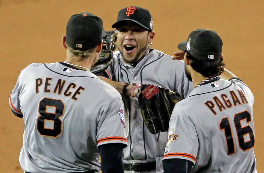 San Francisco's Hunter Pence (8), Gregor Blanco and Angel Pagan (16) celebrate after the 2-0 win. Photo: Charlie Riedel, STF / AP