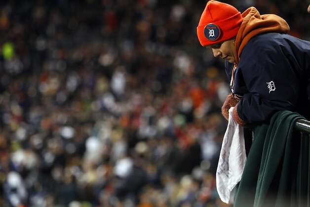 A Tigers fan looks down after the Giants scored two runs in the second inning. The San Francisco Giants won Game 3 of the World Series against the Detroit Tigers on Saturday, October 27, 2012, in Detroit, Mi. The Giants won the game 2-0. Photo: Carlos Avila Gonzalez, The Chronicle