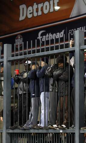 Detroit fans watch through the fence behind left field after the Giants scored two runs in the second inning. The San Francisco Giants won Game 3 of the World Series against the Detroit Tigers on Saturday, October 27, 2012, in Detroit, Mi. The Giants won the game 2-0. Photo: Carlos Avila Gonzalez, The Chronicle