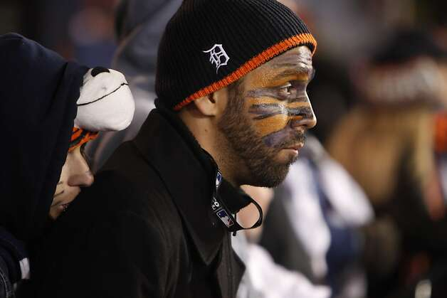 Dan Huereca, right, and his girlfriend, Robyn Young watch as the Tigers are defeated by the Giants. The San Francisco Giants won Game 3 of the World Series against the Detroit Tigers on Saturday, October 27, 2012, in Detroit, Mi. The Giants won the game 2-0. Photo: Carlos Avila Gonzalez, The Chronicle