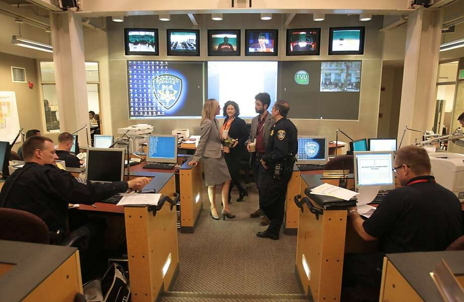 Public safety personnel work in the situation room of the Emergency Operations Center ahead of an Occupy march. Photo: Mathew Sumner, Special To The Chronicle